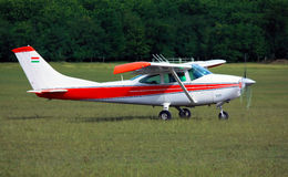 Light red white school airplane. On airport grass before take off Stock Photos