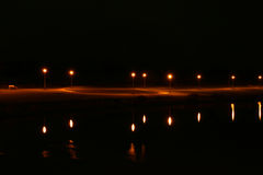 Light and reflection. Lamps and reflection light in pond, night scenery Stock Photo