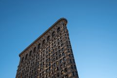 Light reflection on architecture closeup of Flatiron Building in the afternoon in New York City stock images