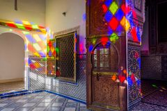 Light reflection, Bahia palace, Marrakech. MARRAKECH, MOROCCO - DECEMBER 11: Colorful light reflection at the interior of Bahia palace in Marrakech. December Royalty Free Stock Image