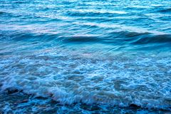 Light reflection on the surface of movement sea. On sand beach Stock Photography