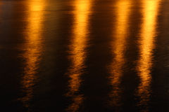 Light reflections. On night river mirror abstract background Stock Image