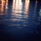 Light reflections on night river - vintage effect. Royalty Free Stock Photography