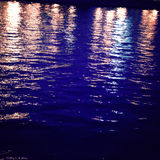 Light reflections on night river - vintage effect. Royalty Free Stock Images
