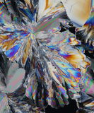 Light refraction in crystals. A colorful abstract background from light refraction in crystals of citric acid Royalty Free Stock Photography