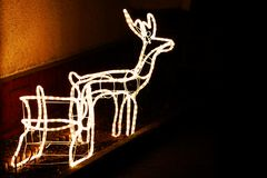 Light reindeer and Santa Claus sleigh. In garden Royalty Free Stock Photo