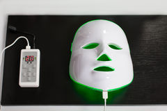 Light rejuvenating mask for facial skin therapy. Stock Photography