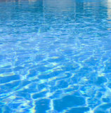 Light rippling on water. Light rippling effects on the surface of swimming pool water Stock Image