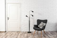 Light room interior with white door. In brick wall stock image