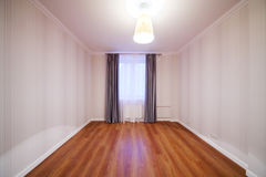 Light room with luster and window with curtains. In new apartment Royalty Free Stock Photography