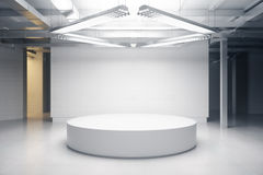 Light room with podium Stock Images