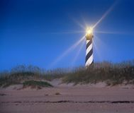 Light's On! at Cape Hatteras Lighthouse NC. Cape Hatteras Lighthouse photographed at dawn while the beacon light was still lit and shining as a guide for ships Royalty Free Stock Image