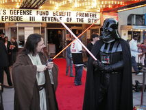 Light Saber Duel. Photo of darth vader and luke skywalker dueling with light sabers at the premiere of revenge of the sith at the uptown theatre in washington dc stock photography