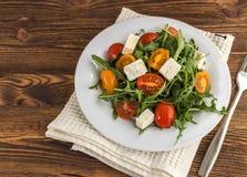Light salad of arugula Stock Images