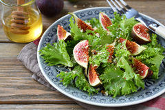 Light salad with figs, lettuce and honey Stock Photography