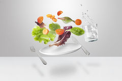 Light salad with floating vegetables Stock Photo