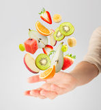 Light salad with flying fresh fruits Royalty Free Stock Photos