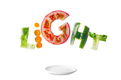 Light salad with flying fresh vegetables. Stock Image