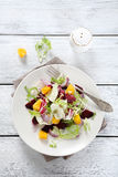 Light salad with oranges on a plate Stock Images
