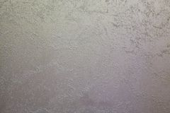 Light sand streaks on a dark, steel background.  Decorative coating for walls - sand Stock Photography