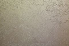 Light sand streaks on a dark, steel background.  Decorative coating for walls - sand Royalty Free Stock Photos