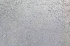 Light sand streaks on a dark, steel background. Decorative coating for walls - sand Stock Image