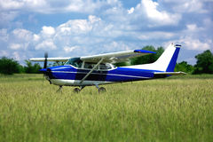 Light school airplane on grass Royalty Free Stock Photo