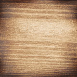 Light scratched square wooden cutting board. Royalty Free Stock Photos