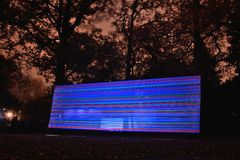 Light sculpture at night, stripes in blue and red Royalty Free Stock Photography