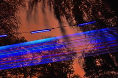 Light sculpture at night, stripes in blue and red Stock Photography