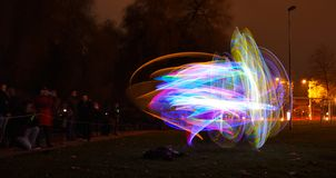 Light sculpture at night, stripes in blue and red Stock Photos