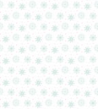 Light seamless blue pattern of many snowflakes on white backgrou. Nd. Soft Christmas winter theme for gift wrapping. New Year seamless background for website Royalty Free Stock Photo