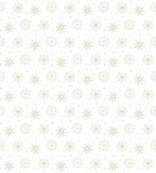 Light seamless gold pattern of many snowflakes on white backgrou. Nd. Soft Christmas winter theme for gift wrapping. New Year seamless background for website Royalty Free Stock Photo
