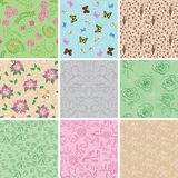 Light seamless patterns with plants and butterflies - set. Of vector backgrounds Royalty Free Stock Image