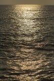 Light from setting sun on Atlantic Ocean Stock Photos