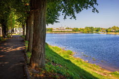 Light-shade of Tver. The Volga River in the sun and on the waterfront walkway in the shade Royalty Free Stock Image