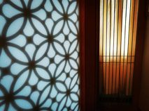 Light and shadow on Asian style door. Stock Photo