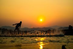 Light and shadow fishermen. Sunset Light and shadow fishermen Royalty Free Stock Photos