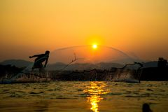 Light and shadow fishermen. Sunset Light and shadow fishermen Stock Photo