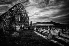 Light and Shadow Game. Before the sun go to set, clouds and light play a last spectacular game to offer amazing contrasts on the church`s ruins. Templetown Stock Photography