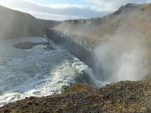 Light and shadow in the mist rising above Gullfoss waterfall in Iceland. Creating a dreamy landscape stock photography