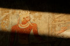 Light and shadow on an old Egyptian carving showing a pharaoh stock image
