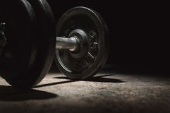 Light and shadow onto a dumbbell. Royalty Free Stock Image
