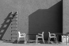 Light and shadow of tables, chairs, stairs and walls. Royalty Free Stock Image