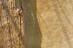 Light and shadow on wood and concrete skin. Light and shadow drop on old wood and concrete skin close up stock photos