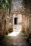 Light and shadows on entrance of a stone corridor in ancient cas Stock Image