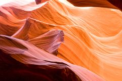 Golden glow of slot canyon. Light shimmers of the walls of antelope flats slot canyon stock images
