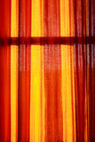 Light shines through blinds orange. Royalty Free Stock Images