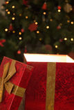 Light shining from christmas present Stock Images