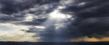 Light shining through clouds Royalty Free Stock Photos